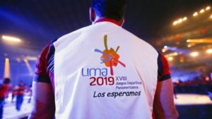 A man wears a shirt with the Lima, Peru 2019 Pan Am Games logo during the closing ceremony of the Pan Am Games Sunday, July 26, 2015, in Toronto. Lima will be the host city for the 2019 Pan Am Games. (AP Photo/Julio Cortez)